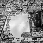 Reflektionen auf dem Kopsteinpflaster der Oberstadt